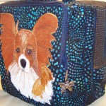 Papillon with a butterfly zipper pull